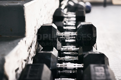Buy stock photo Still life shot of weights in a gym