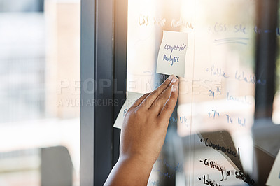 Buy stock photo Closeup shot of an unrecognizable businesswoman brainstorming on a glass wall in an office