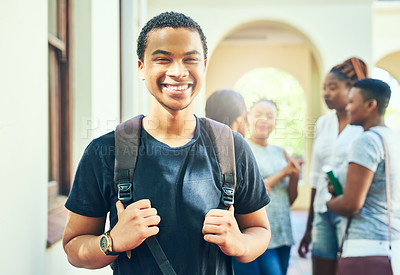 Buy stock photo Cropped portrait of a handsome young male university student on campus with his classmates in the background