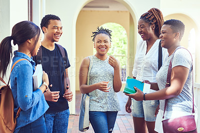 Buy stock photo Cropped shot of a group of young friends talking while standing on campus