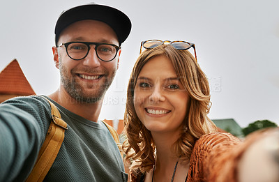 Buy stock photo Cropped shot of a young couple taking a selfie outdoors