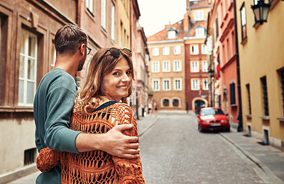 Buy stock photo Rearview shot of a young couple exploring a foreign city