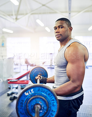 Buy stock photo Cropped portrait of a handsome young athletic man lifting weights in the gym