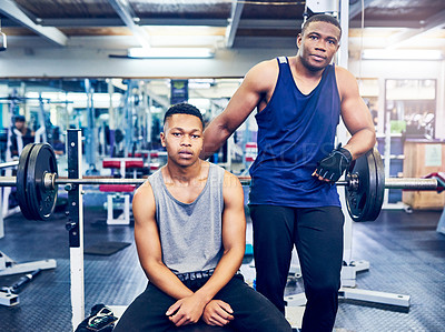 Buy stock photo Cropped portrait of two handsome young athletic men hanging out in the gym between sets