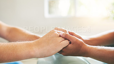 Buy stock photo Cropped shot of a man and woman holding hands in comfort on a table