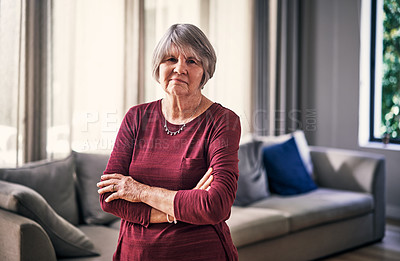 Buy stock photo Cropped portrait of an attractive senior woman standing with her arms folded in her retirement home