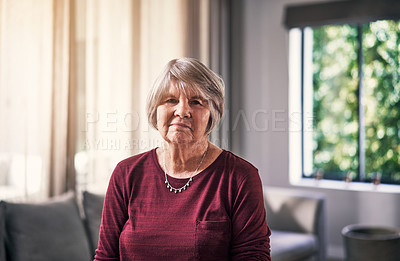Buy stock photo Cropped portrait of an attractive senior woman standing in her retirement home alone
