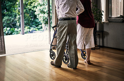 Buy stock photo Rearview shot of an unrecognizable senior couple in their retirement home