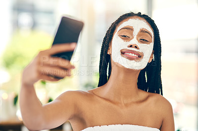 Buy stock photo Shot of an attractive young woman taking a selfie after getting a facial at a beauty spa