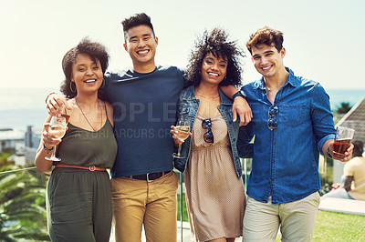 Buy stock photo Portrait of a group of friends having drinks and relaxing outside while on holiday