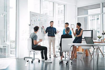 Buy stock photo Shot of a team of businesspeople having a meeting in a modern office