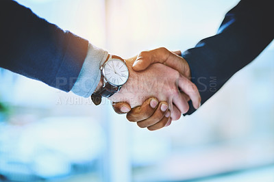 Buy stock photo Shot of two unrecognizable businessmen shaking hands at work
