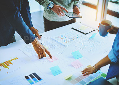 Buy stock photo Shot of a group of unrecognizable businesspeople discussing ideas during a boardroom meeting at work