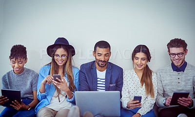 Buy stock photo Cropped shot of businesspeople using their devices against a gray background