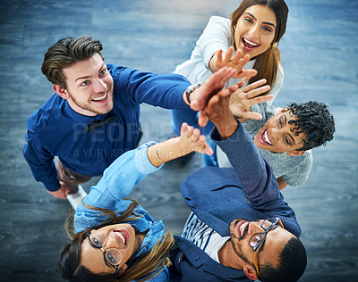 Buy stock photo High angle shot of a group of colleagues celebrating in an office