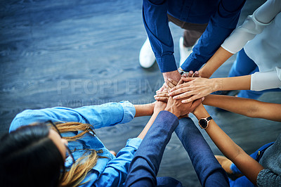 Buy stock photo High angle shot of a group unrecognizable businesspeople joining their hands together in unity
