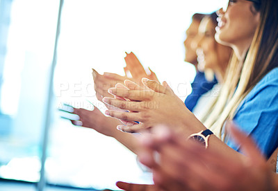 Buy stock photo Cropped shot of colleagues sitting and cheering during an office presentation
