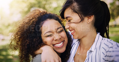 Buy stock photo Shot of two attractive young women posing together while relaxing outdoors