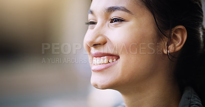 Buy stock photo Closeup shot of an attractive young woman smiling in the city