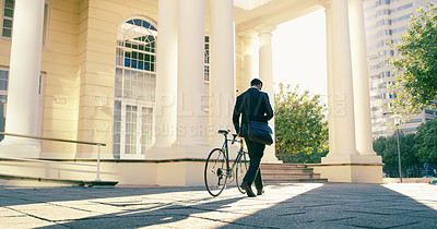 Buy stock photo Rearview shot of a businessman commuting to work with his bicycle
