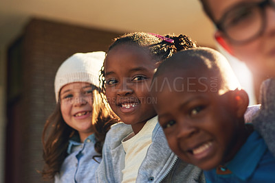 Buy stock photo Shot of a group of elementary school kids posing together outside