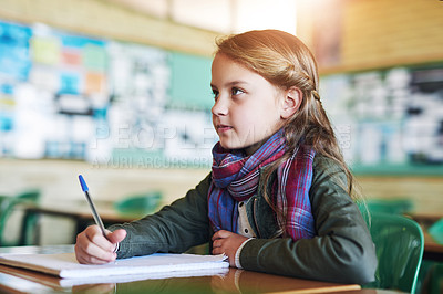 Buy stock photo Shot of an adorable little girl doing her school work in class