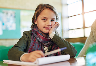 Buy stock photo Portrait of an adorable little girl doing her school work in class