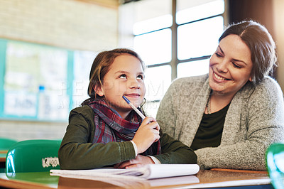 Buy stock photo Shot of an elementary school girl getting help from her teacher in class