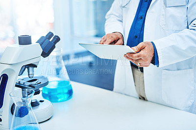 Buy stock photo Closeup shot of a scientist working on a digital in a laboratory