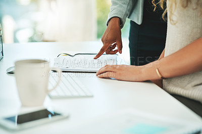 Buy stock photo Closeup shot of two businesswomen working together in an office