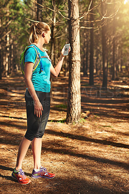 Buy stock photo Shot of a young woman out in nature to exercise