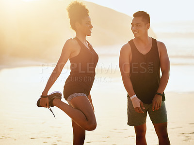 Buy stock photo Shot of a young couple working out at the beach
