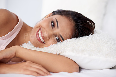 Buy stock photo Shot of a beautiful young woman relaxing on her bed in the morning at home