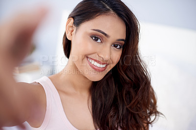 Buy stock photo Shot of a beautiful young woman taking selfies in the morning at home