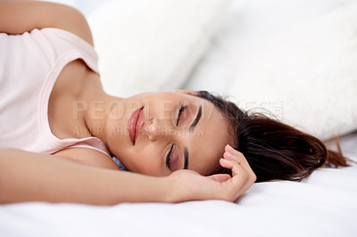 Buy stock photo Shot of a beautiful young woman sleeping peacefully in bed at home