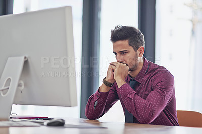 Buy stock photo Cropped shot of a young businessman in deep thought while working in the office
