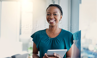 Buy stock photo Portrait of a young businesswoman using a digital tablet in a modern office