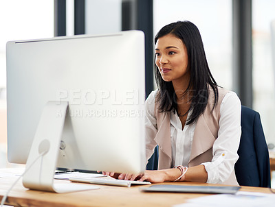 Buy stock photo Cropped shot of a businesswoman working on a computer in the office