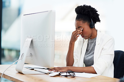Buy stock photo Shot of a businesswoman looking stressed out while working in the office