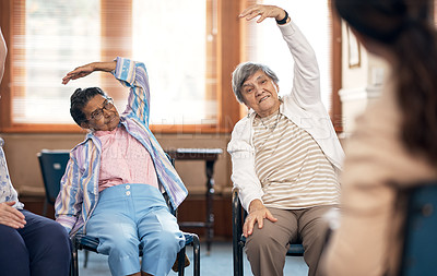 Buy stock photo Cropped shot of a female fitness instructor taking a class in an old age home