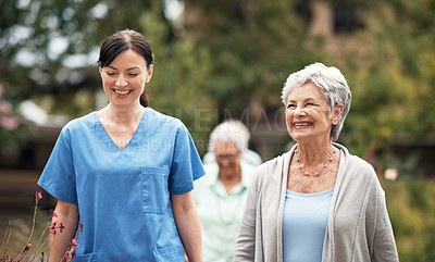 Buy stock photo Shot of a caregiver out for a walk with her senior patient
