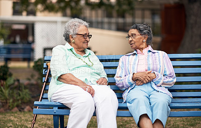 Buy stock photo Cropped shot of two senior women sitting on a bench outside