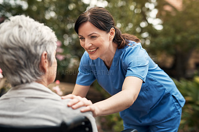 Buy stock photo Shot of a caregiver spending time outdoors with her senior patient