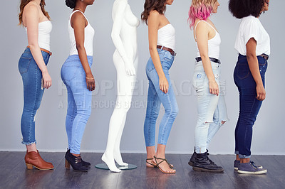 Buy stock photo Studio shot of a group of attractive young women posing with a mannequin against a gray background