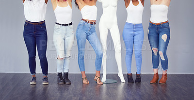 Buy stock photo Cropped studio shot of a group of attractive young women posing against a gray background