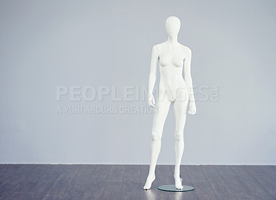 Buy stock photo Studio shot of a white mannequin against a gray background