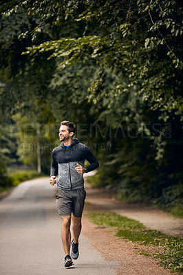 Buy stock photo Shot of a sporty middle-aged man out running