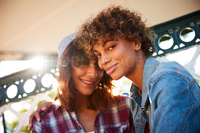 Buy stock photo Cropped shot of a young couple spending the day outdoors on a sunny day