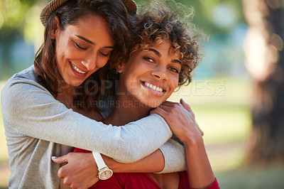 Buy stock photo Shot of a young couple spending the day outdoors on a sunny day