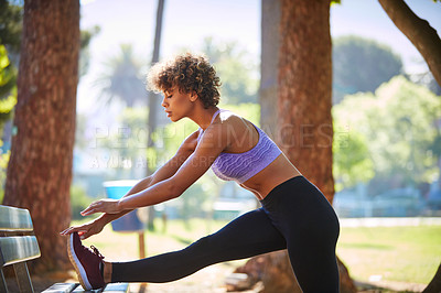 Buy stock photo Cropped shot of a beautiful young woman exercising outdoors